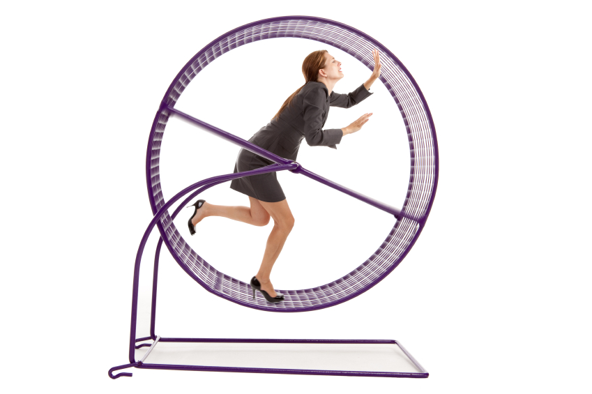Business Woman Running on a Hampster Wheel